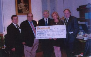Franco Corona presenting a cheque to the Dino Ferrari Centre in 2003